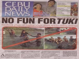 Newspaper article about animal abuse in Oslob